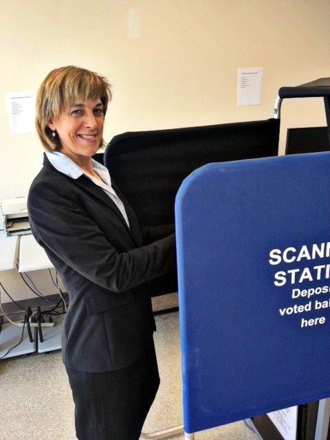 Cecilia Tkaczyk casts her vote during the primary election on Thursday, Sept. 13.
