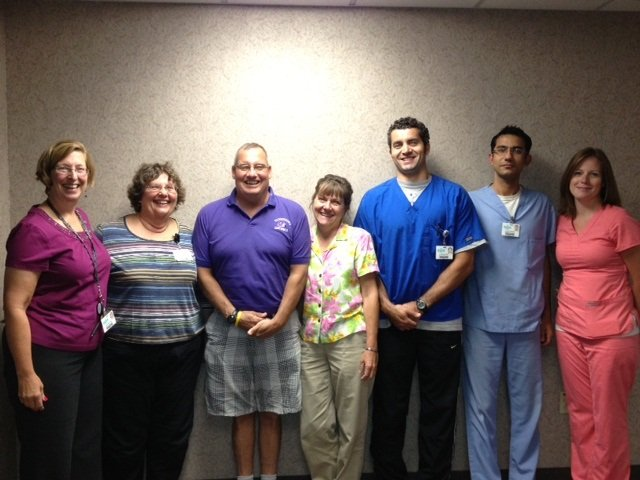 P.J. Joubert with stands with his rehabilitation team at Inter-Lakes Health.  From left are: Merribeth Elling, PT - Director of Rehabilitation Services, Kate VanDerZee, SLP, P.J. Joubert, Teresa Costin, OTR, Leo Gomes, PT, Prashant Malhorta, PT, and Heather Winters, PTA.