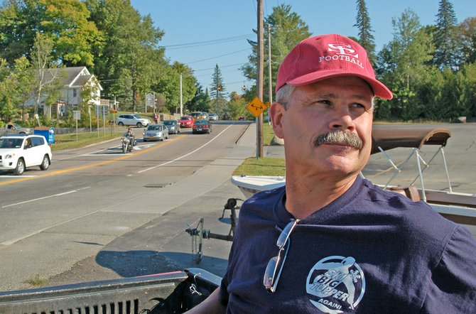 Saranac Lake Mayor Clyde Rabideau heads to Tupper Lake on a high-railer pick-up truck along the railroad tracks Thursday, Sept. 13 to see whether it&#39;s feasible to build a recreation path next to the tracks. He was joined by Trustee Tom Catillaz and members of the media.