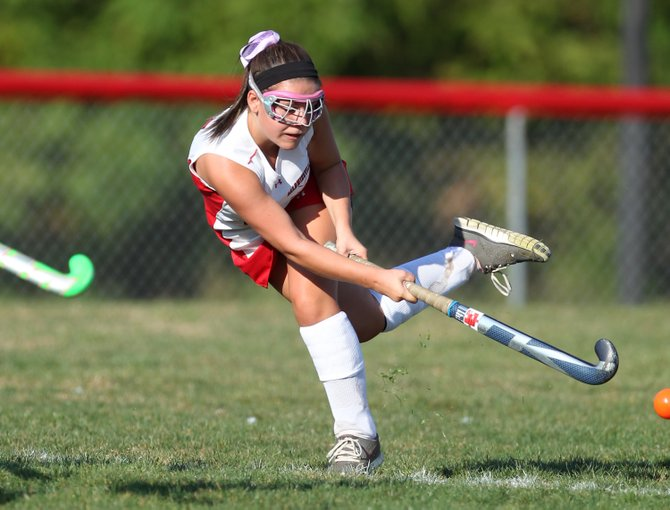 Baldwinsville field hockey midfielder McKenzie Bond sends the ball down the field during last Wednesday's game against Auburn, which the Bees won 2-0.