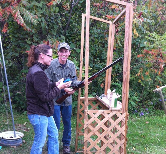 Mike Froats, of the Baldwinsville Rod & Gun Club, helps Brandie Dankiw of Syracuse shoot skeet at the Honeywell Sportsmen's Days at Carpenter's Brook in 2010.