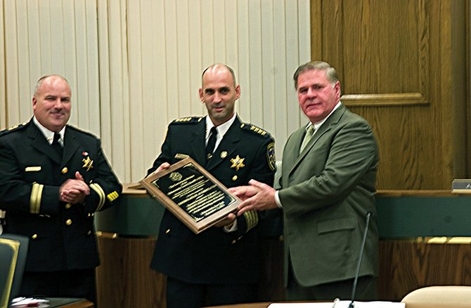 Schenectady County Sheriff Dominic Dagostino, center, is presented with a plaque by Peter Kehoe, executive director of the state Sheriff's Association, after the county correctional facility received accreditation from the group.