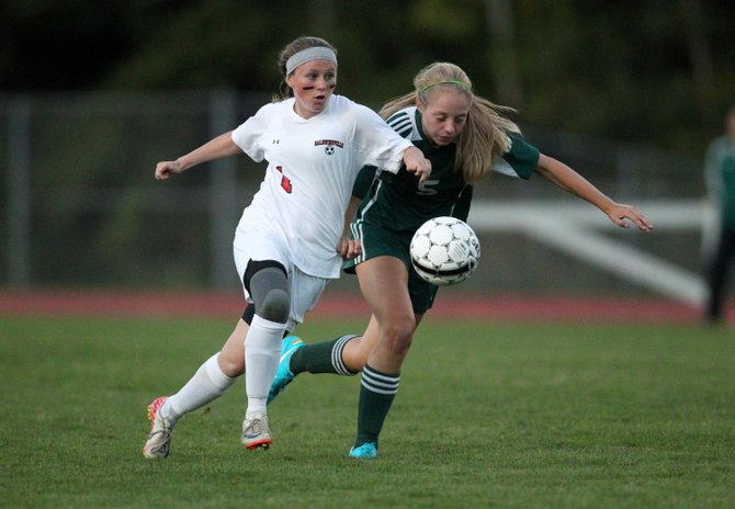 Baldwinsville forward Cassidy Bruen (1) works past Fayetteville-Manlius defender Sarah Barns (5) in Wednesday night's game. Bruen scored both of her team's goals in the second half as the Bees edged past the Hornets 2-1.