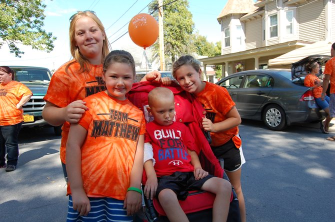 Matthew Wood, and his sisters: Hailee Wood, 7, Chloe Buskey, 13, and Leah Girouard 7, walked to raise awareness and support for Matthew's medical treatment as he fights leukemia.