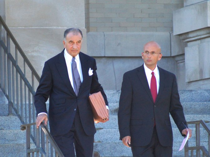 Brian Tait, right, leaves the Madison County Courthouse with his attorney Emil Rossi on Sept. 20. Tait was sentenced to complete three years of probation following his guilty plea to one count of endangering the welfare of a child and one count of sex abuse, both misdemeanors.