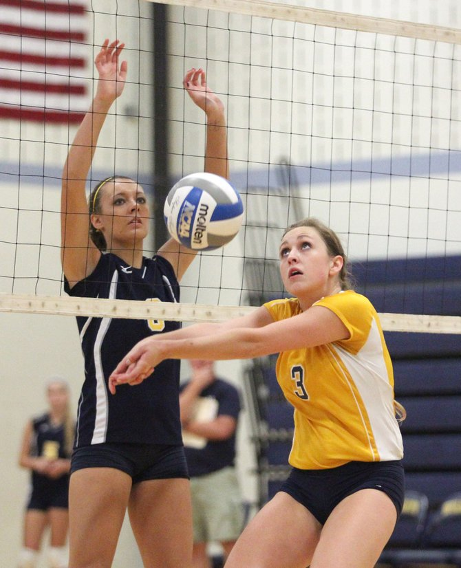 Cazenovia's Amber Robinson (3) passes the ball, watched closely by West Genesee's Brianna Richardson, in last Monday's match. Robinson had 13 assists, 17 digs and eight kills in the Lakers' five-set loss to the Wildcats.