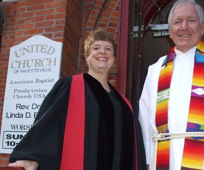 The Rev. Linda Even (left), pastor of The United Church of Fayetteville, is pictured with her cousin, the Rev. David Cramp, during a celebration of her 20th year of ordination Sept. 16.