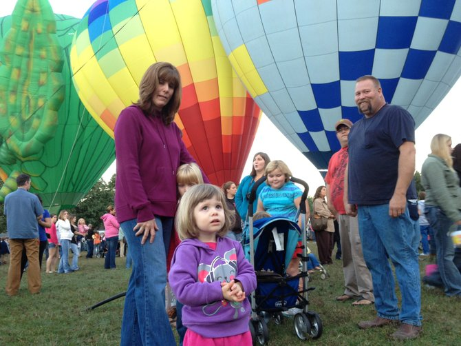 Katelyn Bradley, her sister Karen and parents Connie and Ryan Bradley -- all of Hudson Falls -- watch liftoffs at the Adirondack Balloon Festival's opening ceremonies held Thursday Aug. 20 in Crandall Park, Glens Falls. The festival continues through Sunday with various activities at the Floyd Bennett Memorial Airport in Queensbury, plus an event-ending liftoff Sunday afternoon in Crandall Park. Read accompanying story for details.