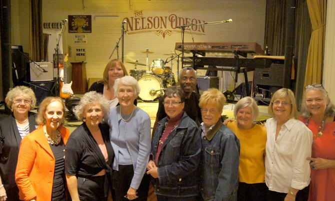 Members of the Cazenovia League of Women Voters gather with Isreal Haganand in front of the Nelson Odeon stage during their Sept. 15 fundraiser. Proceeds from the event will benefit the league's scholarship for a student from Cazenovia High School, as well as the Students Inside Albany program.