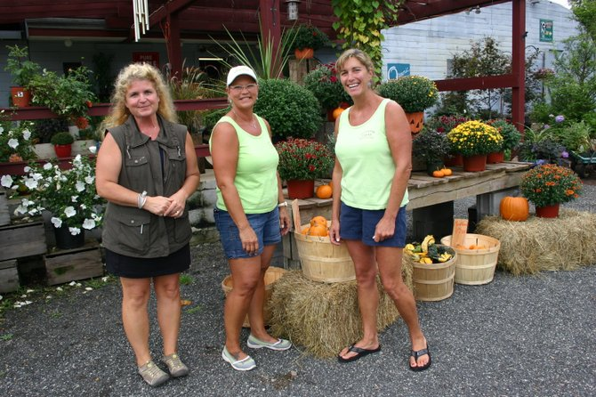 Under new management, Lazy River Farms' staff includes: (left to right): horticulturist Veronica Ross, Judie Tennant, and general manager Katie Galusha.