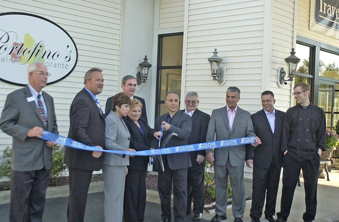 Officials cut the ribbon to open Portofino&#39;s Italian Restaurant at 831 New Loud Rd. in Latham on Thursday, Sept. 13.