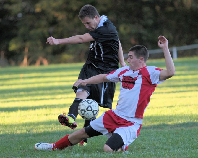 Schroon Lake's Bobby Rose defends against Crown Point's Mike Gould during Northern Soccer League action Sept. 24. Schroon won, 4-3.