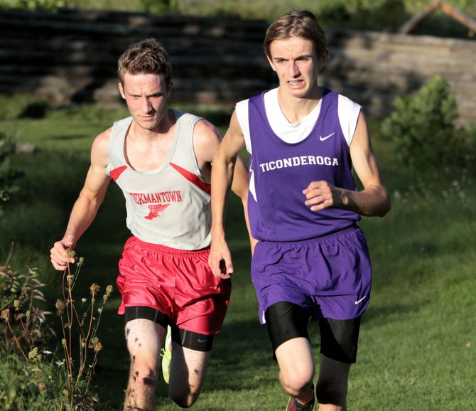Tyler Belden of Ticonderoga leads Beekmantowns James West to the finish line in Champlain Valley Athletic Conference cross country action Sept. 25. Ti won the meet.