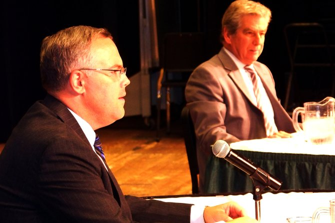 Poised for a debate Tuesday Aug. 23 in their quest for a state Assembly seat  are Warren County Board of Supervisors Chairman Dan Stec (left), a Republican from Queensbury, and Glens Falls Attorney Dennis Tarantino (right), a Democrat. The debate, sponsored by the Adirondack Regional Chamber of Commerce, was held in the Queensbury High School auditorium.