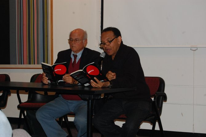  Alexis Levitin (left) and Salgado Maranhao at a poetry reading in Plattsburgh.