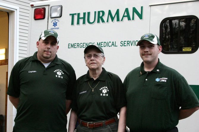 Members of the Thurman Emergency Medical Services — Captain John O'Neill (right), President Jean Coulard (center) and former captain Adam Styers — pose recently for a photograph. The independent agency's funding has been cut from the town's 2013 budget, which is up for a public hearing at 5 p.m. Friday Nov. 16.