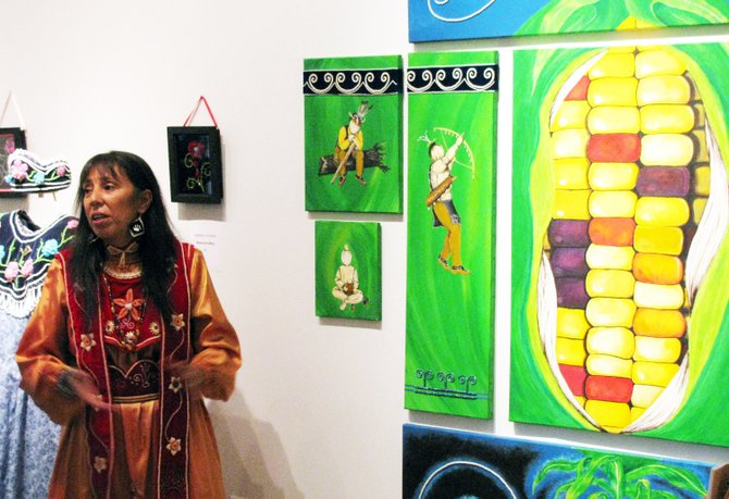 Mohawk artist Towanna Miller discusses one of her paintings.