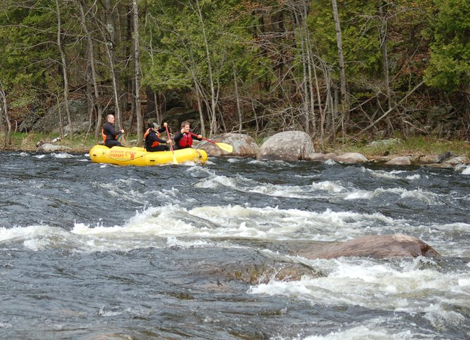 A guide from the Hudson River Rafting Company takes clients down the Hudson River in North River May 5, 2012 during the White Water Derby.