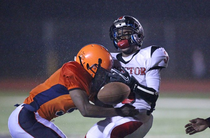 Liverpool linebacker Pat Twum (5) puts a hard lick on Utica Proctor's Lemeke Pittman in Friday night's game, a wild and high-scoring affair won by the Warriors 56-45 as it took over sole possession of first place in the Class AA-1 division.