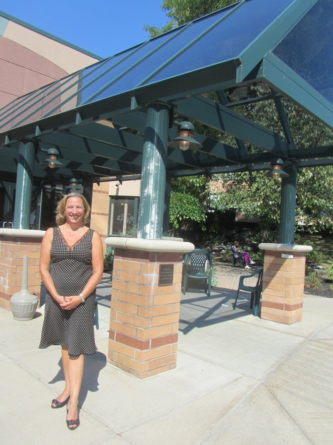 Menorah Park CEO Mary Ellen Bloodgood stands outside the DeWitt retirement home.