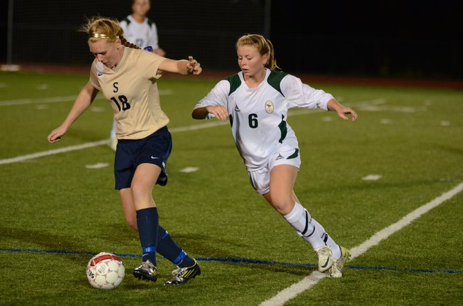 Marcellus defender Shannon Donahue (6) closes in on Skaneateles' Molly Wood (18) during last Tuesday's game. Donahue and the state Class B no. 3-ranked Mustangs' back line was nearly flawless in back-to-back shutouts over Skaneateles and Cazenovia last week.