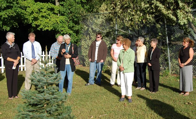 Hanna Kissam shared fond memories of Elizabeth H.W. Lawrence while dedicating a blue spruce in her honor.