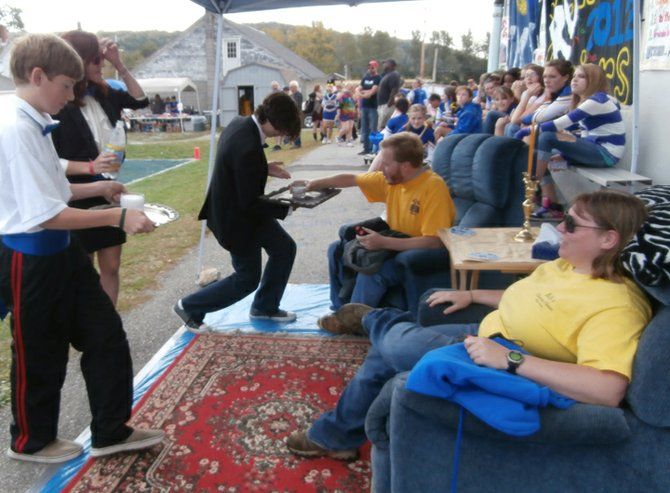 Poultney High School raffle winner enjoy the life of ease while being served aboard Lazyboy brand recliners at last week's home football game. The raffle ticket winners, Kaitlin Cioffi and Jason Grote, are served by classmates Jack Sawyer and Austin Bach. The waitress is Kate LaRose.