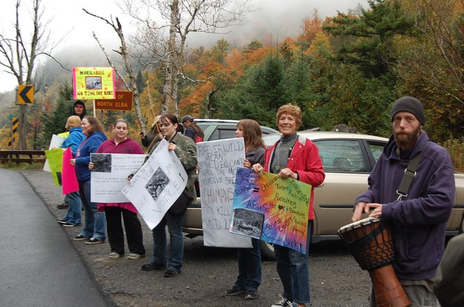 Nine people held a protest on Sept. 29 against the DEC shooting of a moose on the Wilmington Notch.
