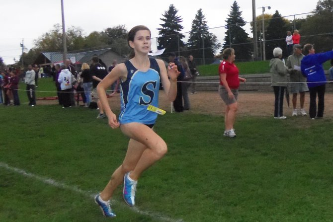 Skaneateles girls cross country eighth-grader Julia Willcox sprints to the finish during last Friday's Penfield Irondequoit Invitational in Rochester. By taking 29th in the race, Willcox helped the team contend with four of the top big school  teams in the state before finishing in fifth place.