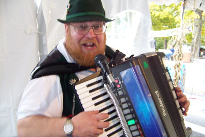 Accordion player Herb Liebenhagen of Latham sings a traditional German song Saturday Oct. 6 during a performance at Lake George Oktoberfest. The village&#39;s festival of German food, music crafts and family fun  featuring the main downtown block cordoned off for pedestrians  continues Sunday Oct. 7 through late afternoon.