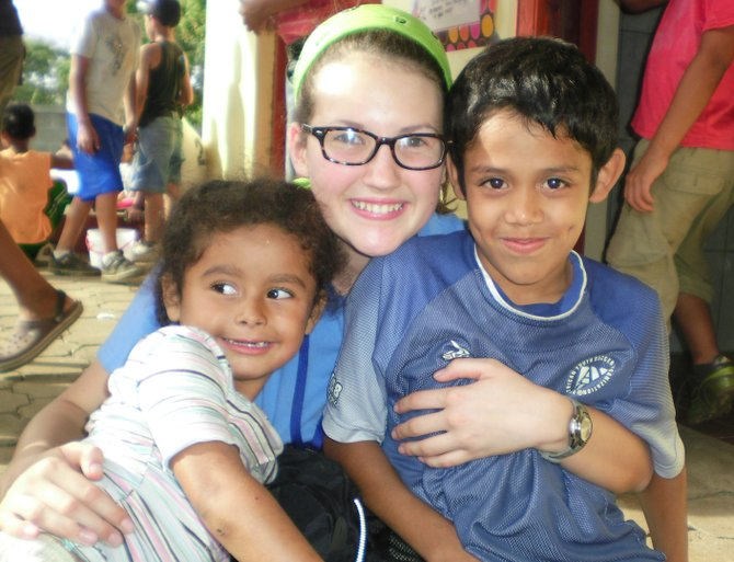 "Clare Whitney, a Schroon Lake teen, poses with students from the Chiquilistagua Publico school in Nicaragua. Whitney is planning a ""Bike and Hike"" Nov. 3 to raise lunch money for students at the school."