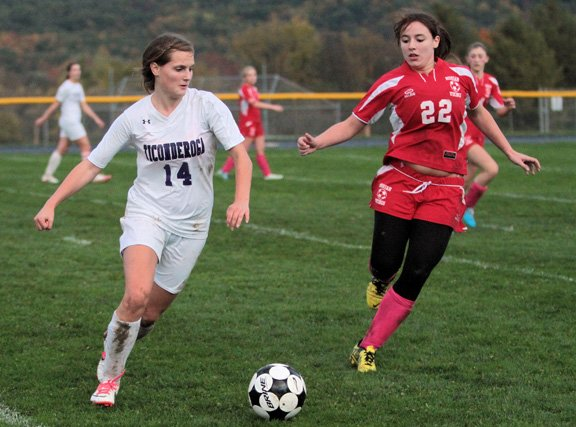 Ticonderoga's Keeley Cooper and Moriah's Katie DeSimone race for a loose ball in Northern Soccer League play Oct. 10. Ti won, 1-0.
