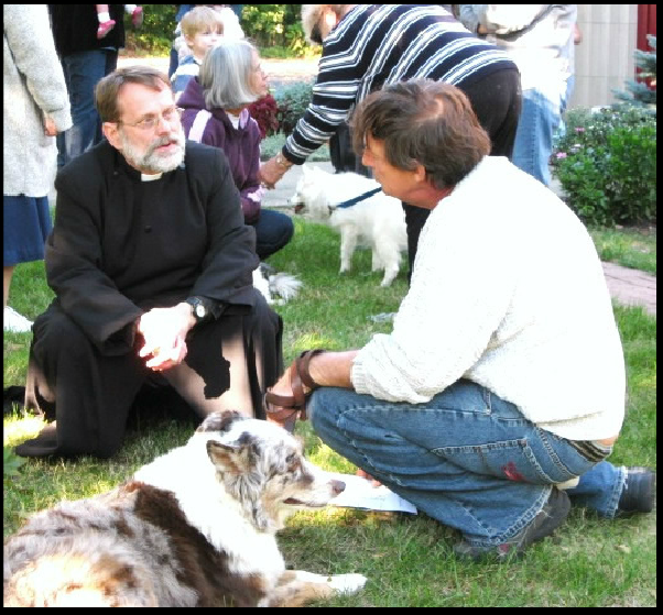 Father Richard Lehmann of St. Matthews blessing a pet.