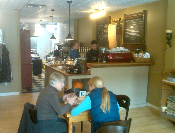 Pewter Spoon Café baristas prepare orders while customers eat lunch. The new business, which is located at 87 Albany St. and owned by Pat Carmeli, opened on Friday, Oct. 5 in Cazenovia.