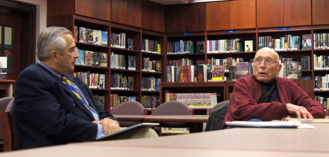 Cazenovia Central School District Superintendent Bob Dubik, left, discusses the districts' concussion management programs with resident Donald Kruger during the latest community forum on Oct. 11 in the high school library.
