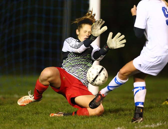 Baldwinsville girls soccer goalkeeper Jaclyn Hingre makes one of her 19 saves on Cicero-North Syracuse's Hanna Haven during Tuesday night's game. Hingre helped the Bees defeat the Northstars 1-0 in a battle of state-ranked teams.