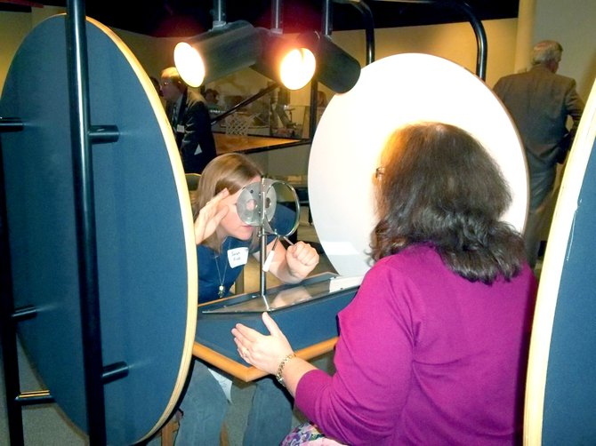 """Visitors to miSci in Schenectay try out the interactive activities that are part of a new exhibit called """"Seeing."""" Developed in partnership with the Exploratorium in San Francisco, """"Seeing"""" represents a major shift for miSci, formerly the Schenectady Museum."""