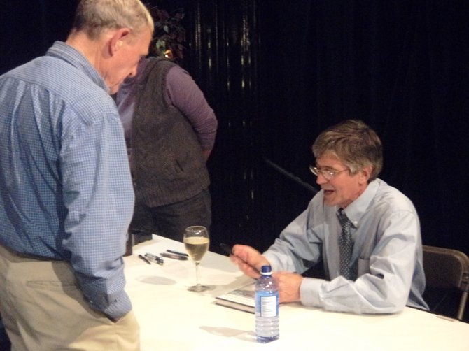 James Steinberg, a former Deputy Secretary of State and the current Dean of the Maxwell School of Citizenship and Public Affairs at Syracuse University, speaks with local residents and signs copies of his book following Cazenovia Forum presentation on Oct. 4 at Catherine Cummings Theater.