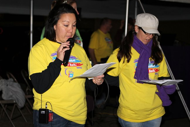 Anita Johnson, left, and Carrie Pertak, co-chairwomen, open the Relay for Life of Crown Point. The event featured teams walking on a track at the school from 7 p.m. Saturday, Oct. 6, to 7 a.m. Sunday, Oct. 7. Walkers raised money — through pledges, find-raising events and other activities — to be donated to the American Cancer Society.