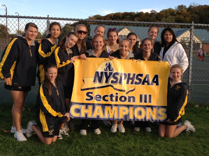 The Skaneateles girls tennis team with the Section III Class C championship banner. The Lakers defeated Copenhagen 4-1 in Wednesday's championship match at Mott Tennis Center in Utica.