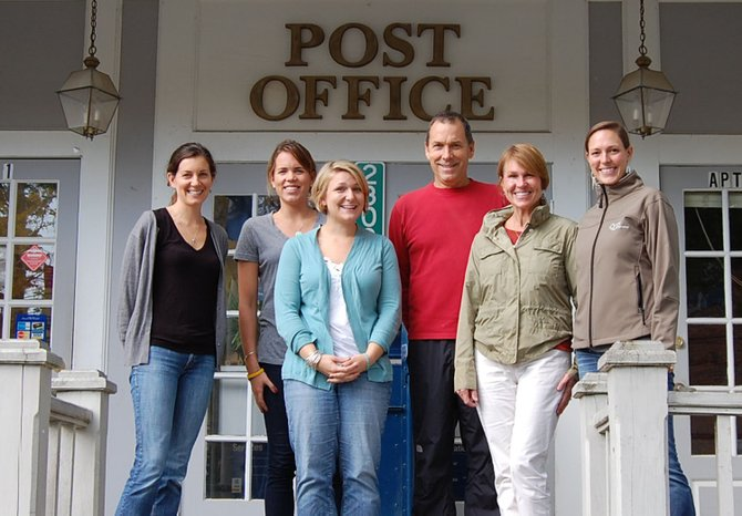 CFES members Kim Calhoun, Sarah Dalton, Emily Lewis, Tara Lamber, Rick Dalton and Karen Dalton, stand together outside the town post office building which will also serve as the organizations home.