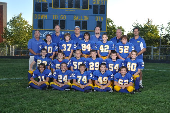 The Cazenovia Pop Warner B-Team players and coaches gather for a group photo on Buckley-Volo Field. The team was named division champions and clinched the top spot for playoffs after defeating the North Utica Raiders on Oct. 6.