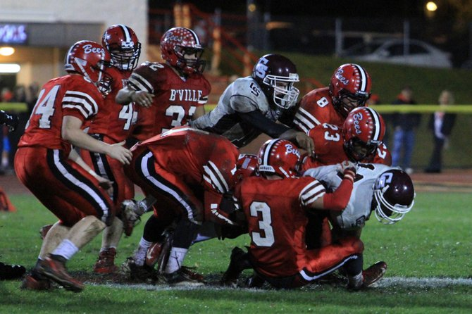 Seven Baldwinsville football defenders, led by Eric Anthony (8), Ricky Sparks (23) and Joe Stanard (3), converge to make the tackle in Friday night's Class AA playoff game against Central Square. The Bees beat the Red Hawks 63-20 as Anthony returned an interception 88 yards for touchdown and caught a 34-yard pass for another score.