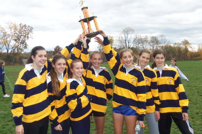 The Skaneateles girls cross country team celebrates its victory at last Saturday's Marion Invitational near Rochester. Earlier in the week the Lakers, by beating Hannibal 18-43, clinched the OHSL Liberty division regular-season title and recorded its 17th undefeated season. In the last 23 years, Skaneateles has won the league title 18 times.