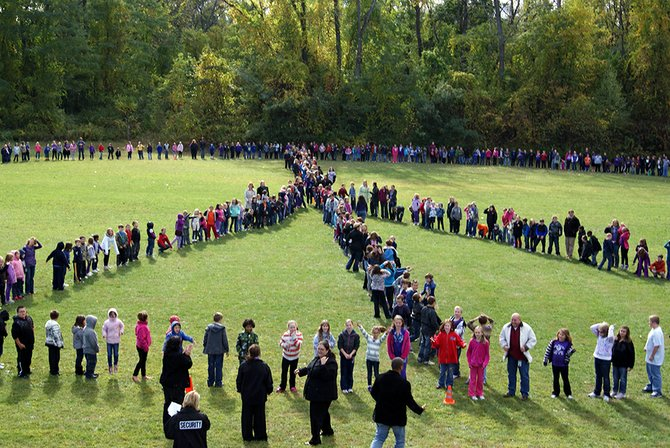 Pinewood Intermediate School students form a living peace sign Friday, Oct. 12, as part of the school's anti-bullying campaign.