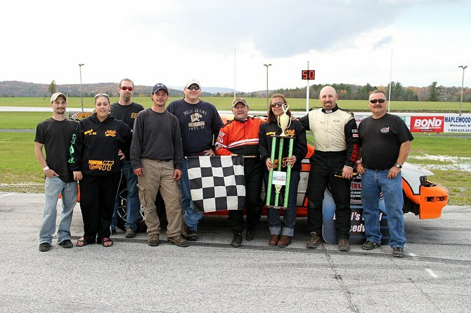 "Vermonster 150 Enduro winner ""Wild Bill"" Fountain and team celebrate their victory at Devil's Bowl Speedway."
