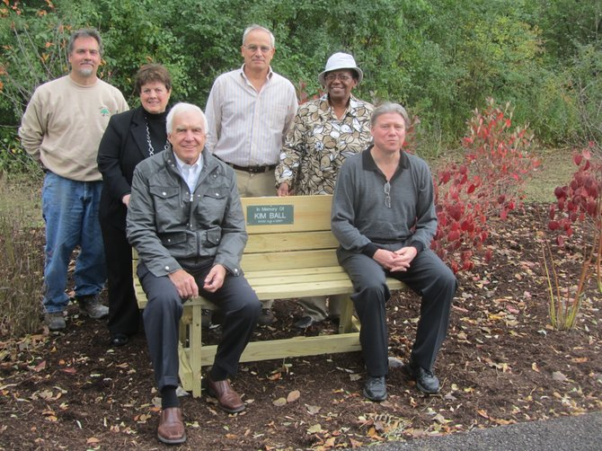 DeWitt Rotarians and local officials gather around a new bench at the Butternut Creek Recreation and Nature Area that the Rotary Club dedicated in memory of former Parks and Recreation Director Kim Ball. Pictured from left are: DeWitt Superintendent of Parks Dale Longden, DeWitt Rotary President Sue Reisman, Rotarian Don Burns, DeWitt Director of Operations and Sustainability Mike Moracco, Rotarian and County Legislator Linda Ervin and DeWitt Town Supervisor Ed Michalenko.