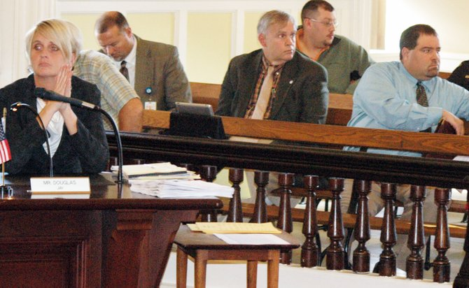Essex County District Attorney Kristy Sprague, front, listens during the sexual offender laws task force meeting Oct. 22 along with local school superintendents Paul Savage (AVCS), A. Paul Scott (ELCS) and William Larrow (Moriah).