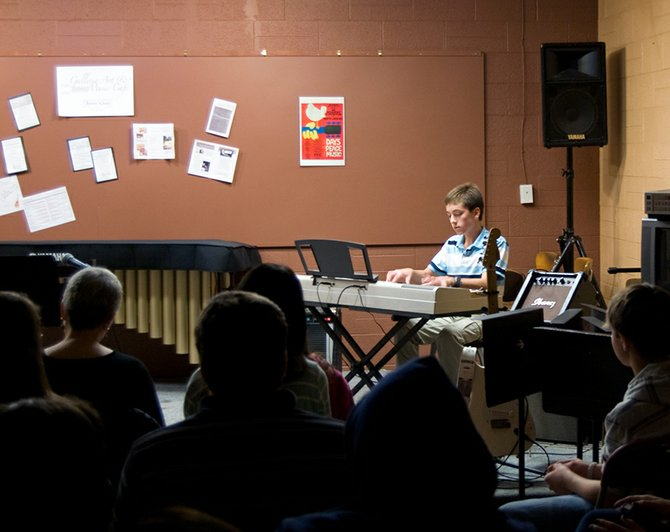 William Smith performs at Brown School's open mic night on Friday, Oct. 12, at its new music cafe. The space was designed to give younger musicians a venue to perform in front of an audience.