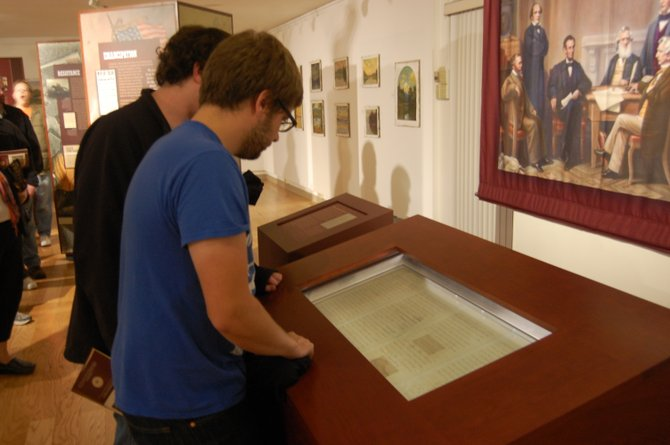 Peter Ivarson and Dustin Nicholson view the preliminary Emancipation Proclamation at Plattsburgh State.
